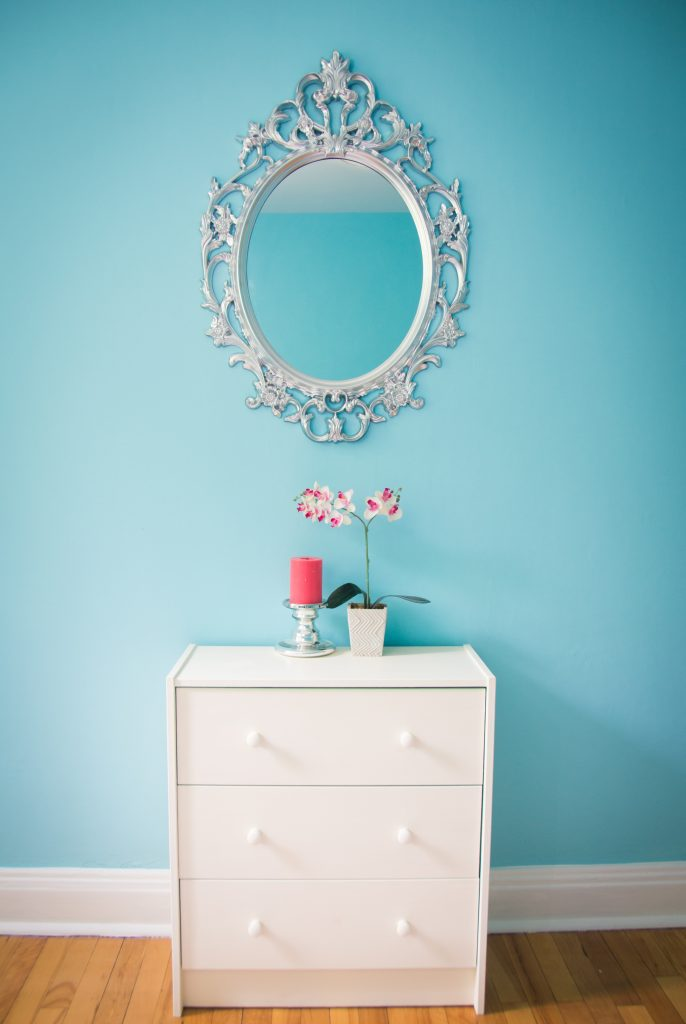 guest bedroom decor style interior decorating blue coral candle orchid Ikea ornate mirror dresser