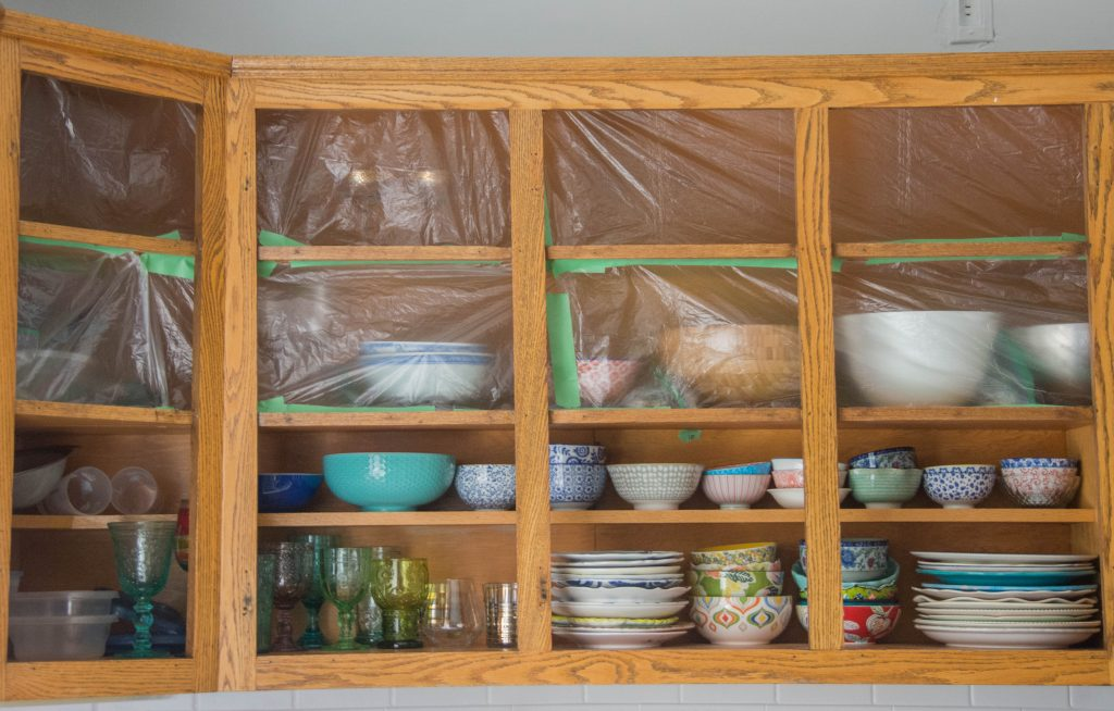 covering cabinets with plastic stain oak wood cabinets Montreal lifestyle DIY blog